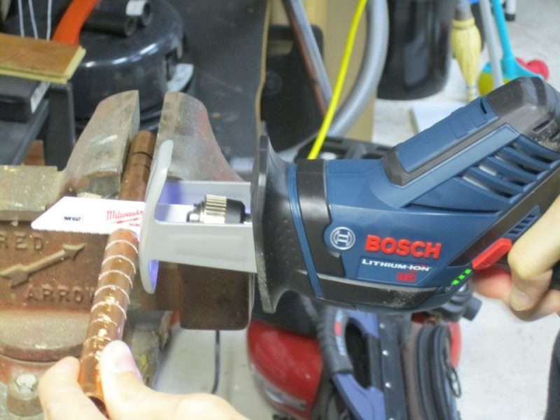 12v mini reciprocating saw in action