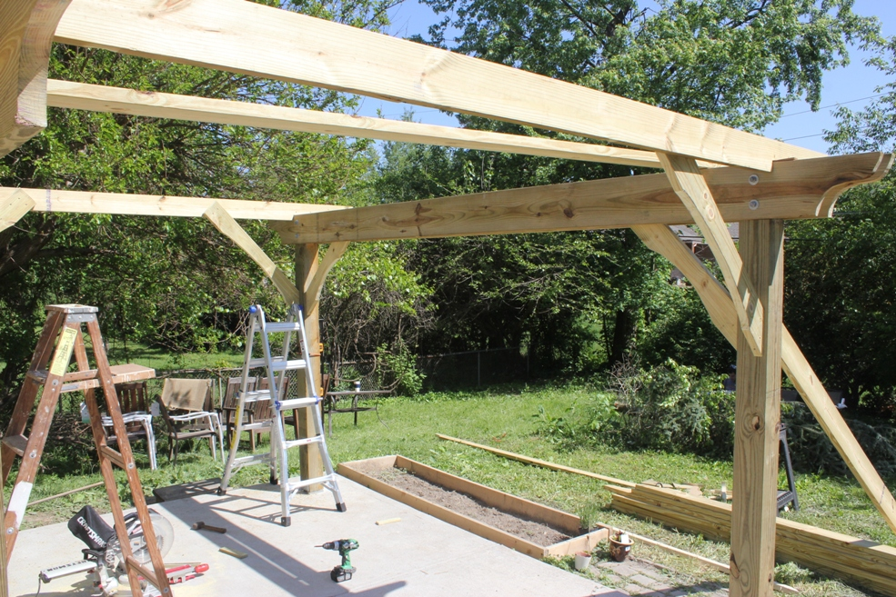 Header bracing provides stability first-pergola-joists-in-and-braced - How To Build A Pergola In Two Days On A Budget - Detailed How-To