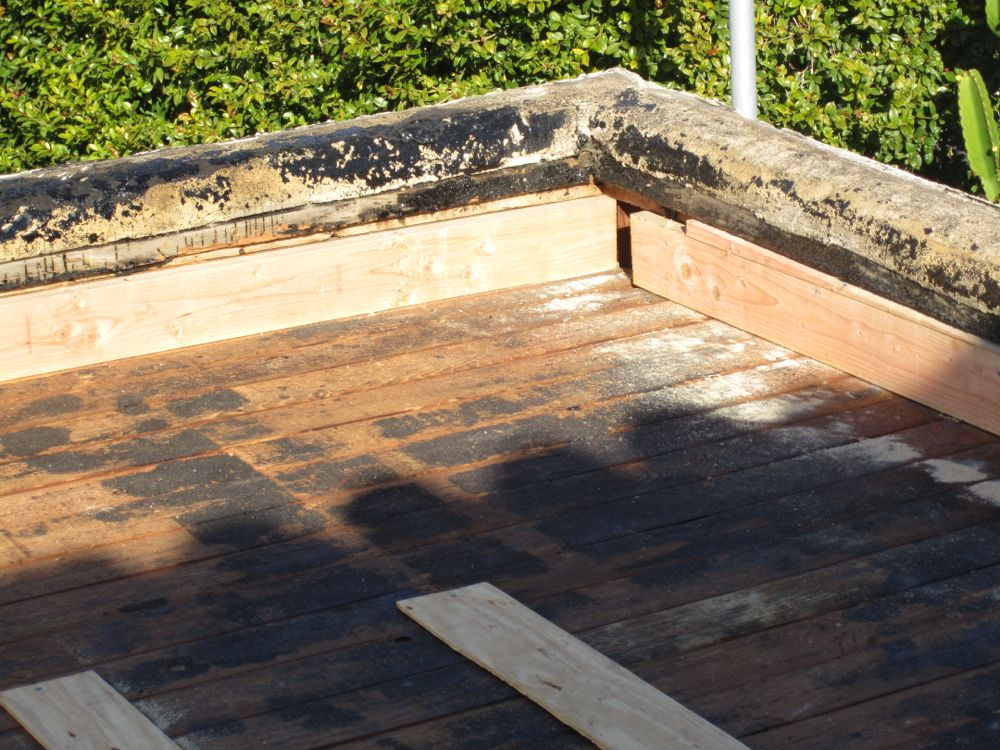 how to change a flat roof
