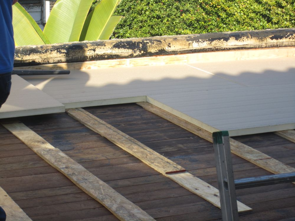 how to build a pitched roof over a flat roof