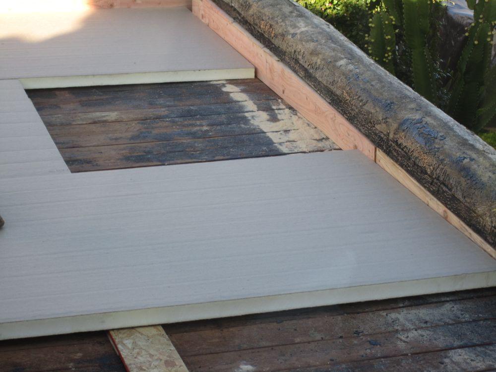 Staggered Rigid Foam Insulation. Flat Roof Insulation Installation