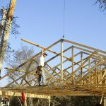 Author Eric Brennan Setting Trusses