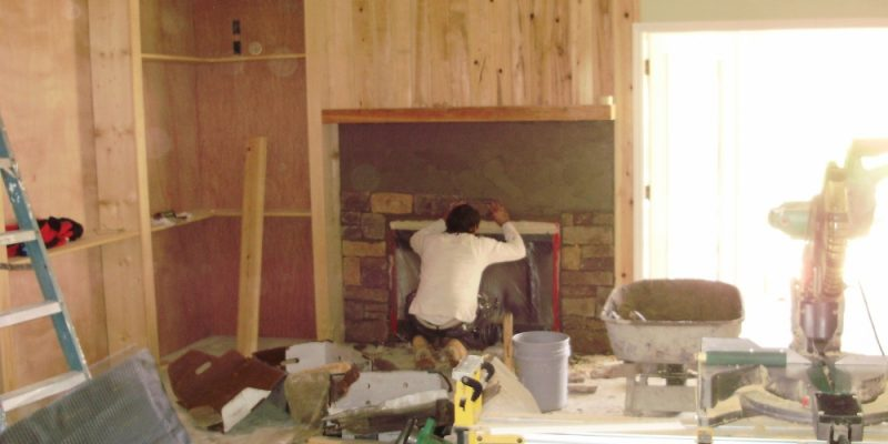 How to install stone veneer on the inside of your home to create a beautiful stacked stone fireplace.