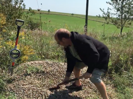 Moving rock with a shovel is painful.