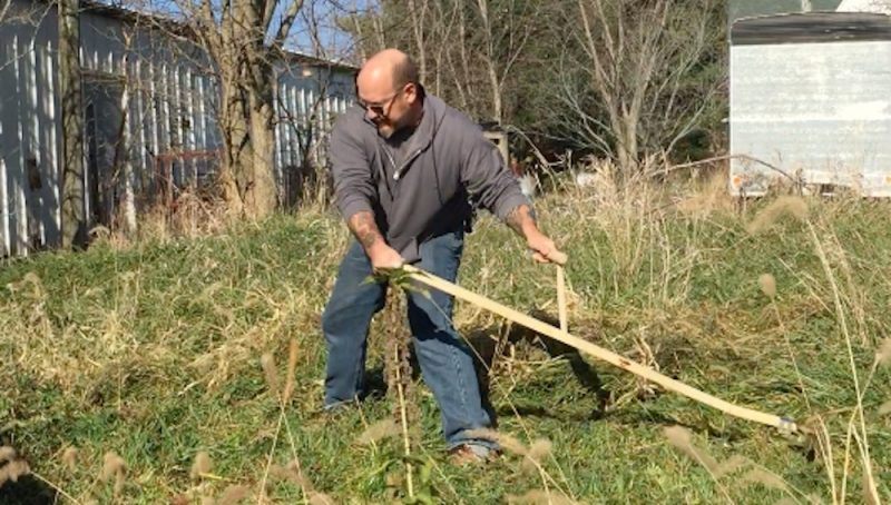 Mowing a banked ditch takes practice!  A shorter blade helps...