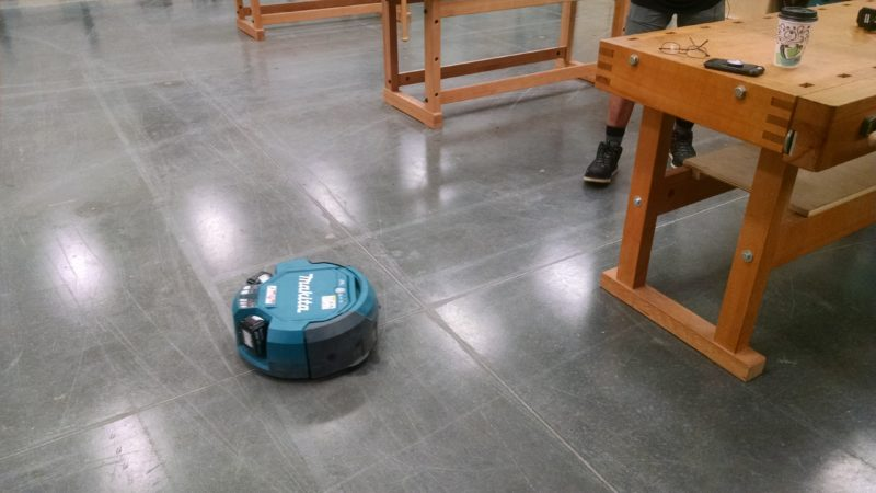 robotic vacuum cleaner roaming free on the floor