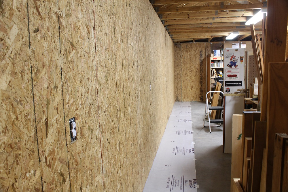 How to sheathing garage walls with plywood and insulate for Cheapest way to build a garage