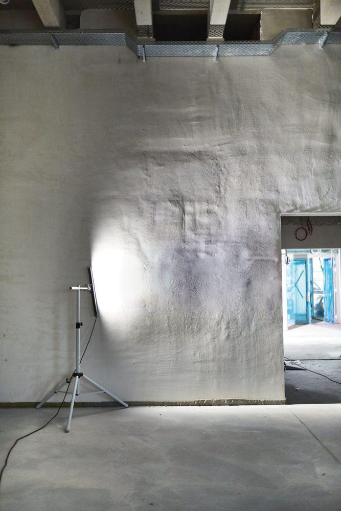 Raking light over wall surface