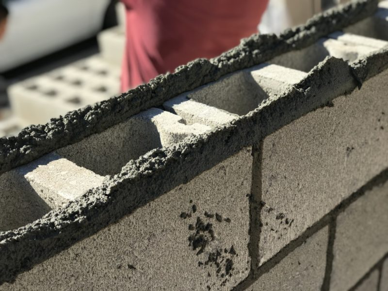 applying the mortar to the concrete blocks