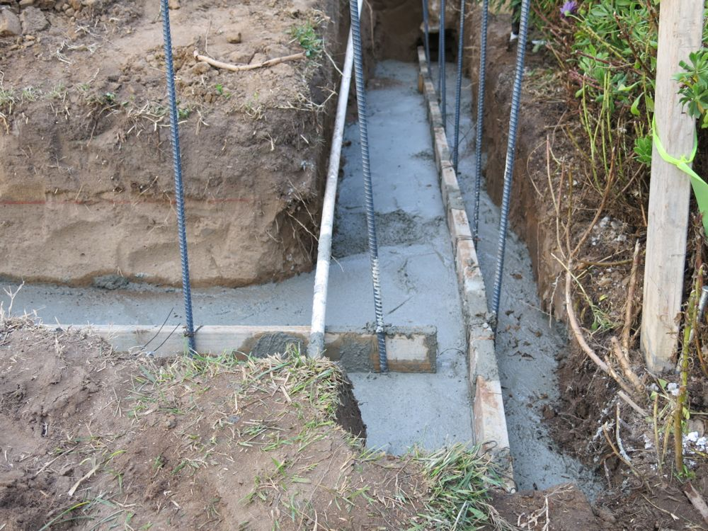 How to build a cinder block retaining wall footing