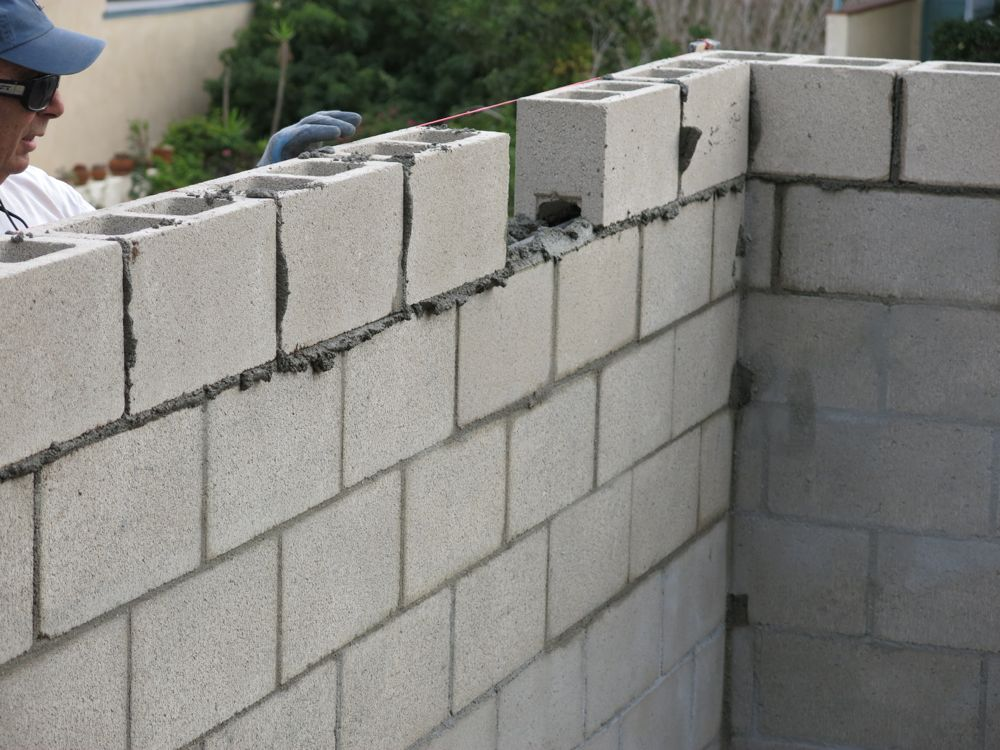 How to build a concrete block wall part 2 home fixated for Cement block wall cost