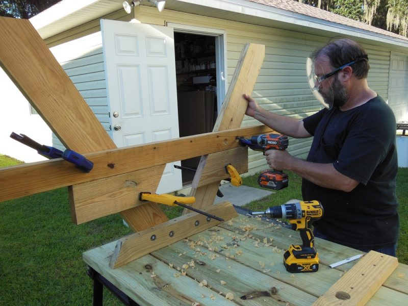 Fasten bench supports in place.