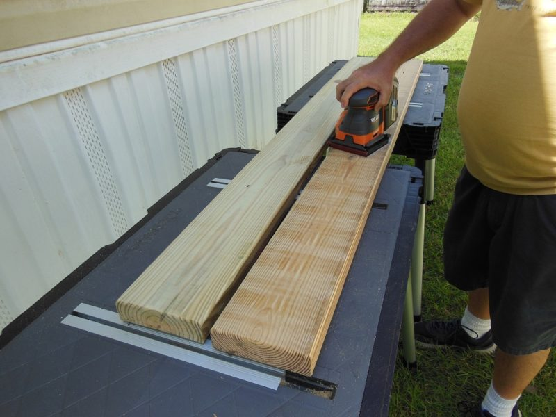 Sanding bench slats.
