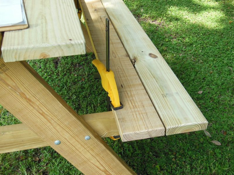 Bench slats clamped to picnic table.