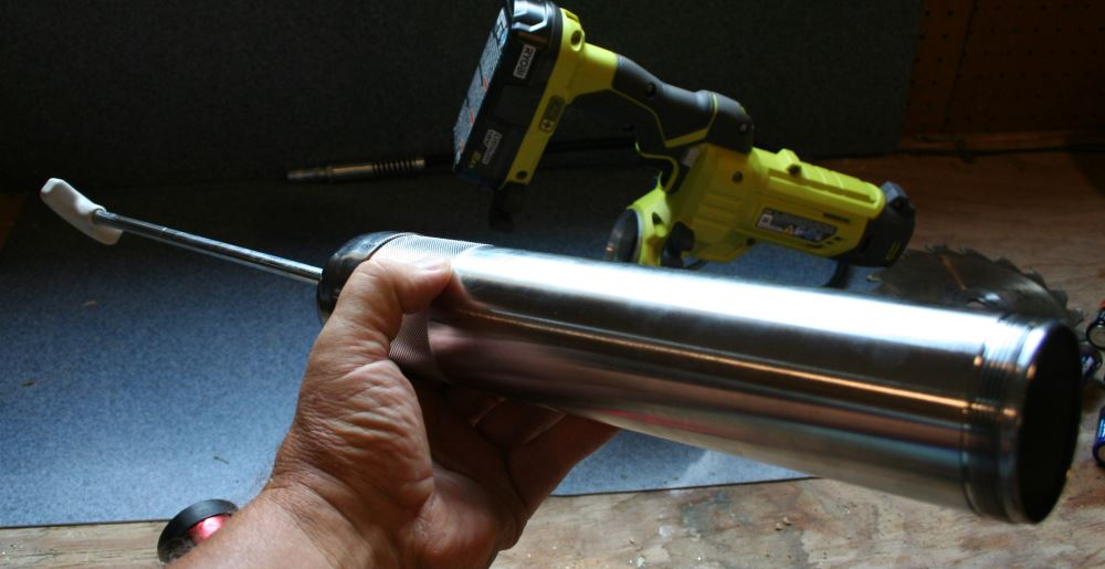 Pull back the spring loaded rod and lock into place