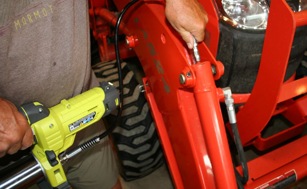 The numerous bushings on the bucket tractor need to be greased frequently to avoid excessive wear and slop