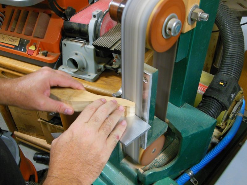 Shaping with a vertical belt sander.