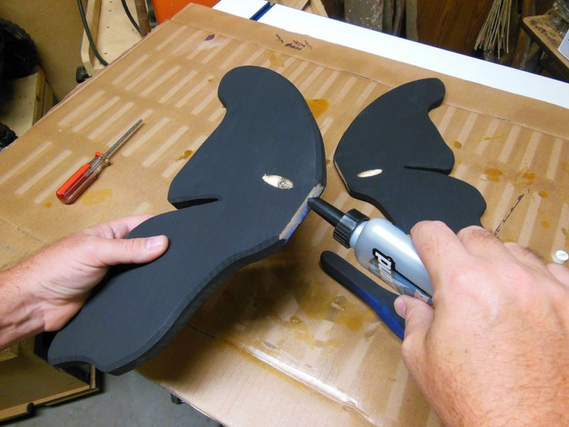 Attaching the wooden butterfly wings.